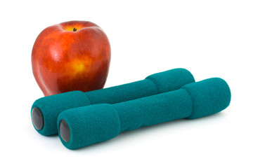 Apple and dumbbells isolated on white background