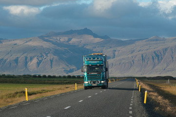 A truck on road from mountains