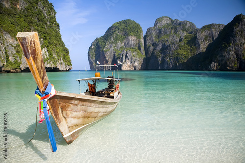 canvas print picture A longtail boat sits in Maya Bay, Koh Phi Phi Ley, Thailand