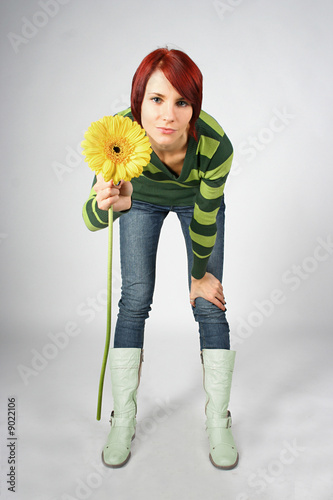 redhead girl with yellow flower