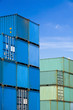 shipping cargo containers stacked at freight terminal