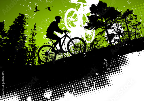 Mountain bike in a forest abstract background