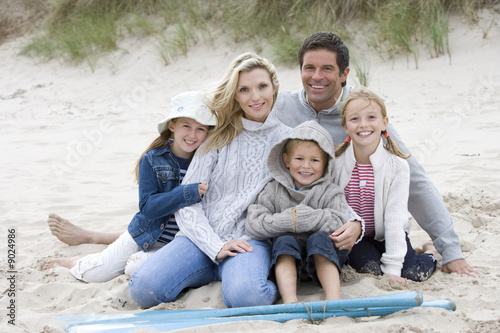 Portrait of young family on beach