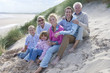 Portrait of multi-generation family sitting on beach