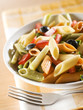 colorful pasta with pepper, pumpkin and black olive close up