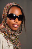 Portrait of yong trendy african female model with sunglasses poster