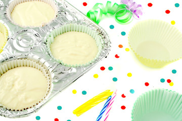 cake flour mix in baking pan with tinsel ribbons, candles,