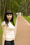 pretty brunet girl walking in the park poster