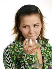 Young thoughtful woman with glass of white wine.