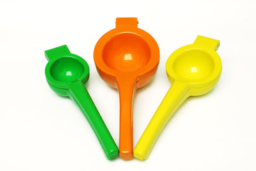 Lime, Orange, and Lemon squeezers on white background