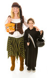 Boy & girl in halloween costume getting ready to trick or treat poster