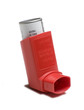 Red asthma inhaler on white background