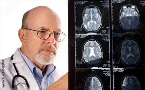 Senior Doctor viewing MRI scans