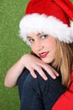 Christmas teen resting on her knee, with a happy smile poster
