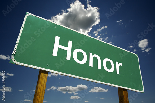 Honor Road Sign with dramatic clouds and sky.