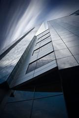 Detail of modern skyscraper. Psychodelic sky.