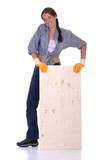 woman carpenter holding wooden plank on white background poster