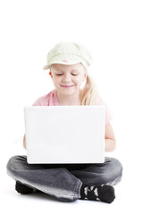 Young girl using a laptop computer over white