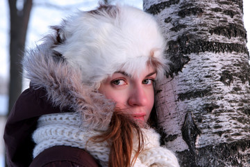 A portrait of young woman in winter outwear