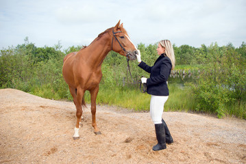 Girl -a jockey and horse.Contact with nature