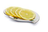 Lemon slice on porcelain plate on white background poster