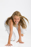 Teenage blonde girl standing on her knees and laughing poster