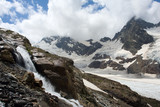 Waterfall and high mountains with glacier on background poster