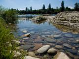 Fototapety Mosaïque de cailloux dans le fond de la rivière