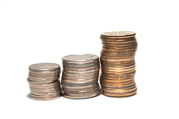 Three stacks of coins loking like bar-graph