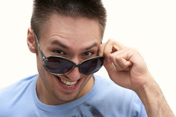 cheerful teacher removes glasses, isolated background