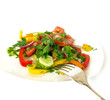 Freshness vegetarian salad and a fork isolated