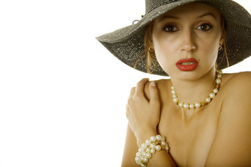 Sexy woman in hat and jewelry