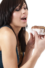 Portrait of a beautiful young brunette woman tempted to eat