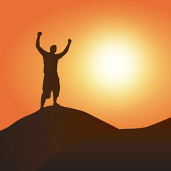A silhouette of a man atop a mountain with his arms up