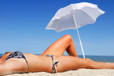 Unrecognizable young adult female Person lying down on beach poster