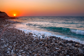 Sunset at Mediterranean beach. Samos Island, Greece.