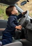 cute little boy driving a car poster