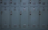 Green colored school lockers, typical of a high school. poster
