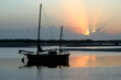 Ancient old ketch moored peacefully at sunrise.