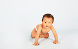 Cute baby crawling isolated shot over blue background poster