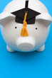 Piggy bank with graduation cap, saving for college