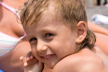 portrait of little boy on a beach