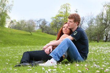 happy young couple relaxing outdoors