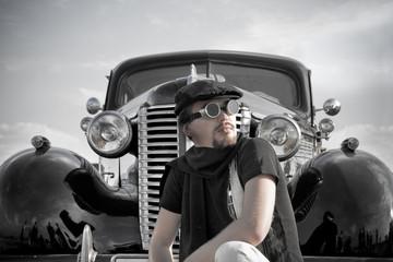 Portrait of driver near the vintage car.