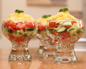 Dish with salad with cucumber, tomato , mayonnaise and cheese