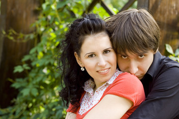 outdoor portrait of young happy attractive couple together