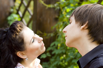 outdoor portrait of young happy attractive flirting couple