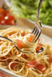 fresh spaghetti on fork and spoon close up shoot.
