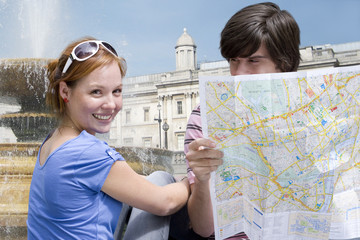 Couple sightseeing with map