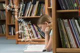 Girl reading a book in library